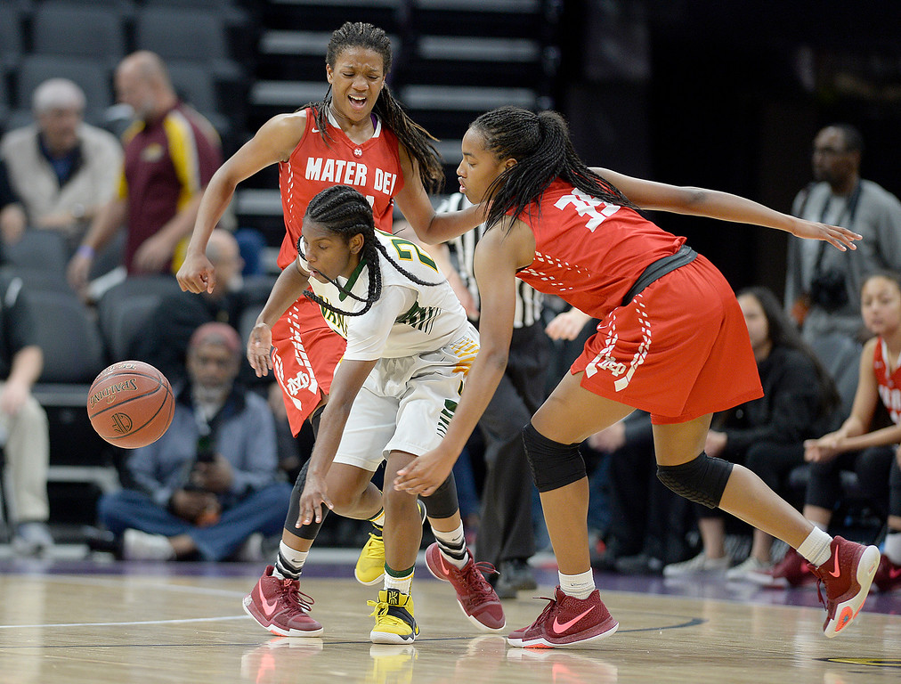 . Vanden\'s Deirdre Huff fights through Mater Dei\'s Kaleigh Pugh (left) and Cyndi Lewis during the third quarter of the of the Vikings 64-61 victory over the Monarchs in the CIF Girls Division II State Championships Saturday at Golden 1 Center in Sacaramento. Joel Rosenbaum -- The Reporter