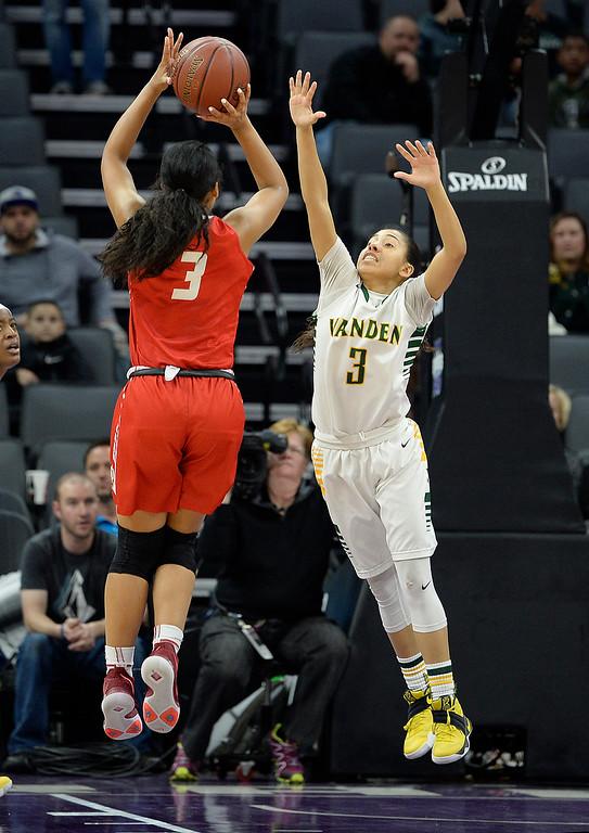 . Vanden\'s Jenessa Herrera defends the basket as Mater Dei\'s Nicole Freeman makes a shot attempt during the fourth quarter. Joel Rosenbaum -- The Reporter