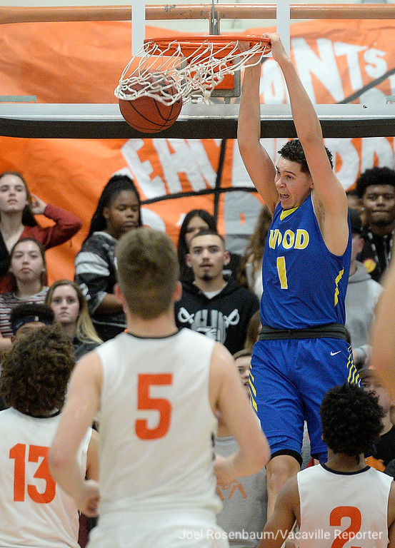 . Will C. Wood\'s Jay Nagle throws down a dunk for two of his team leading 11 points in the Wildcats 49-47 loss to their rivals, Vacaville High School Friday at Harold Youngblood Gymnasium.