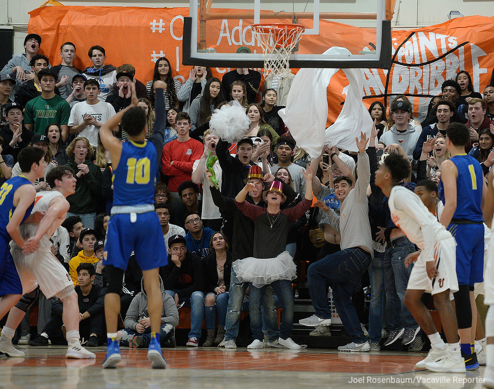 . Fans in the Vacaville High student section attempt to distract Wood\'s Angelo Harris as he shoots free-throws in the second quarter of the Bulldogs 49-47 victory over the Wildcats.