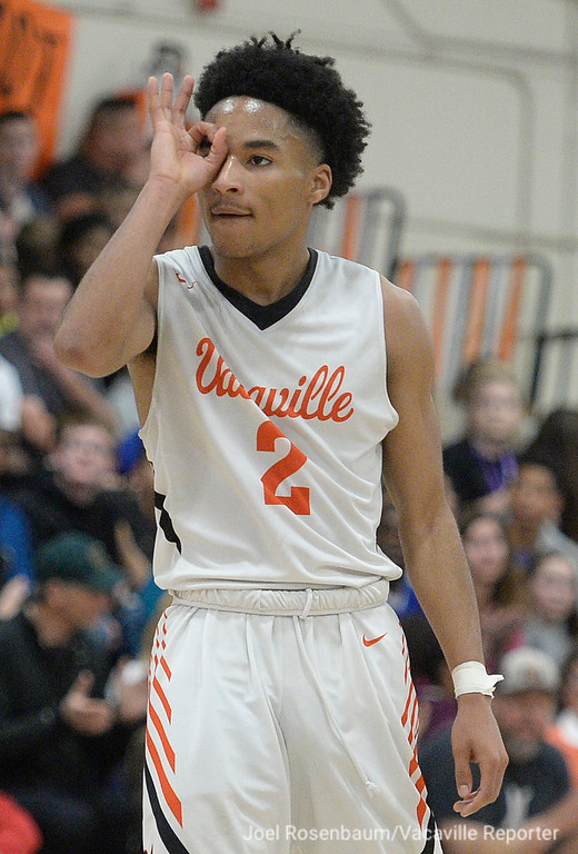 . Vaca High\'s Johnathan Tubbs celebrates hitting a three-point basket in the fourth quarter of the Bulldogs 49-47 victory over their rivals, Will C. Wood Friday at Harold Youngblood Gymnasium. Tubbs lead the \'Dogs with 11 points.