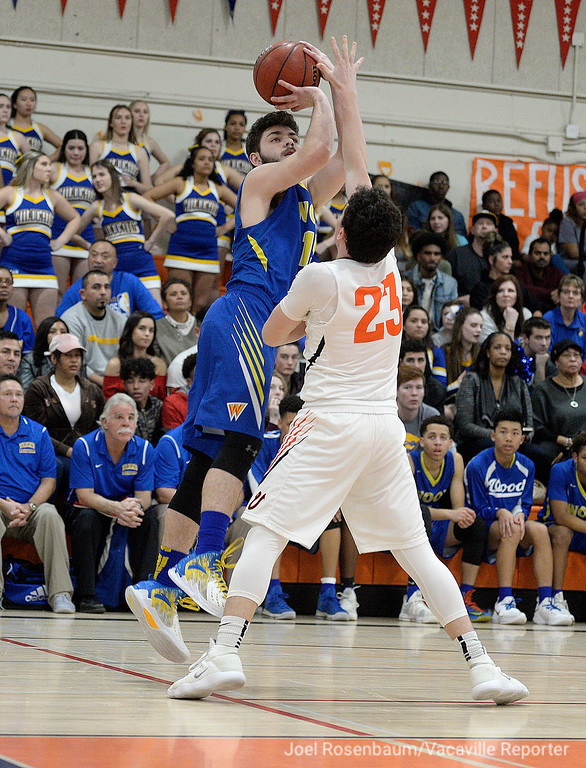 . Wood\'s Michael Wudel pulls up for a jump shot over Vaca\'s Cameron Mitchell during the third quarter.