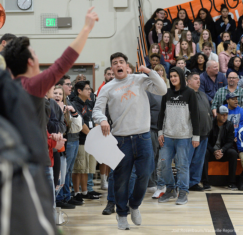 . Vaca High senior, Nathan Gomez, fires up the student section before tip off of the Bulldogs showdown with Wood Friday at Harold Youngblood Gymnasium.
