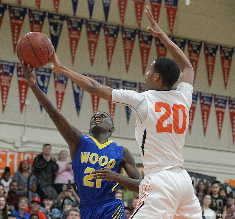 . Vaca High\'s CJ Toler blocks the shot of Wood\'s Jeremiah Jones during the third quarter of the Bulldogs victory over their cross-town rivals.