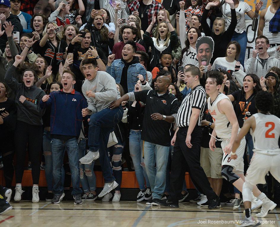 . The Vaca High student section erupts after Zack Perlstein\'s (far right) sank the winning basket in their first place showdown with cross-town rival Will C. Wood Friday at Harold Youngblood Gymnasium.