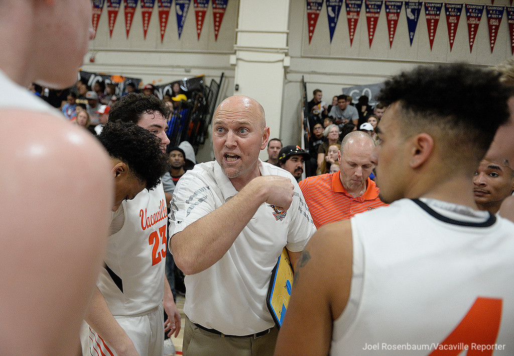 . Vaca High head coach, Duane Kamman talks with his players during a third quarter timeout.