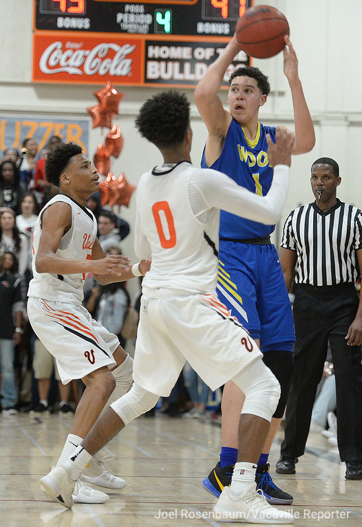 . Will C. Wood\'s Jay Nagle looks for an open teammate as he fights the double-team of Vaca High\'s Myron Amey (left) and Jordan Adams in the fourth quarter.