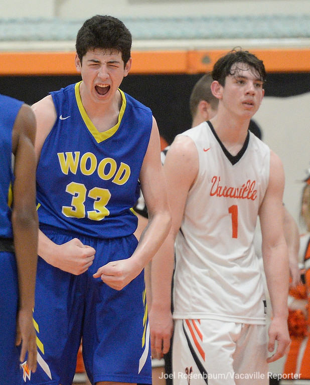 . Will C. Wood\'s Landon Seaman celebrates after draining a basket and drawing a foul during the fourth quarter.