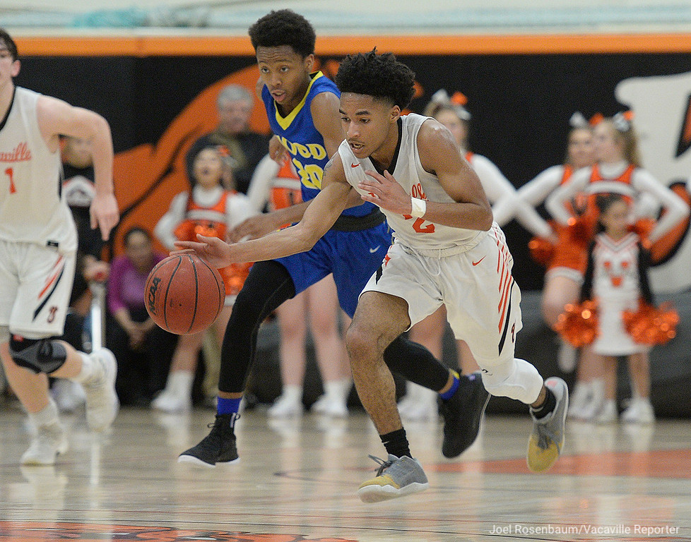 . Vaca High\'s Johnathan Tubbs leads the break after making a steal during the fourth quarter.