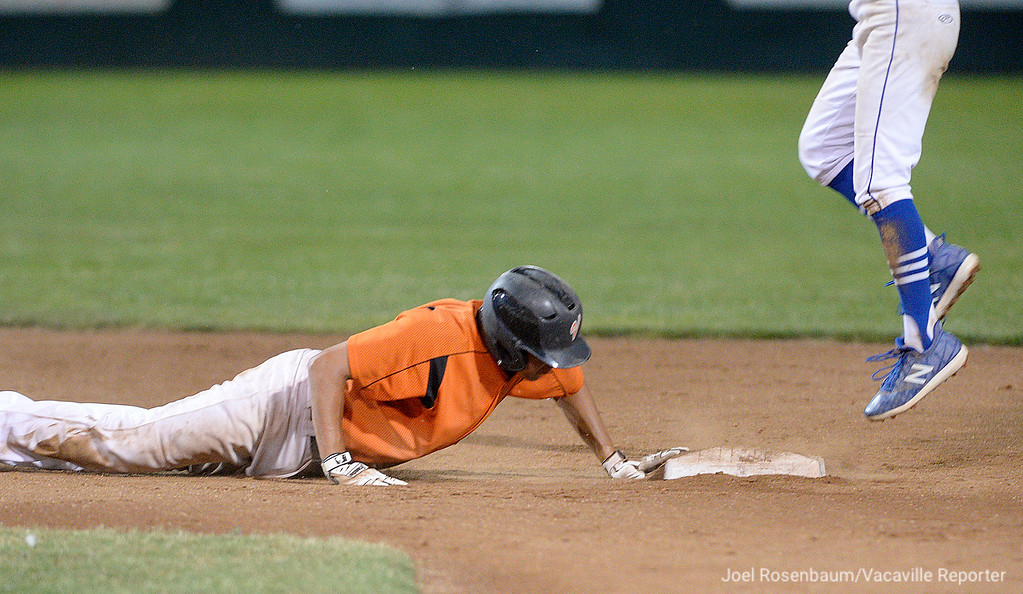 . Vaca\'s Noah McCoy dives back to second base safely on a pickoff attempt during the second inning.