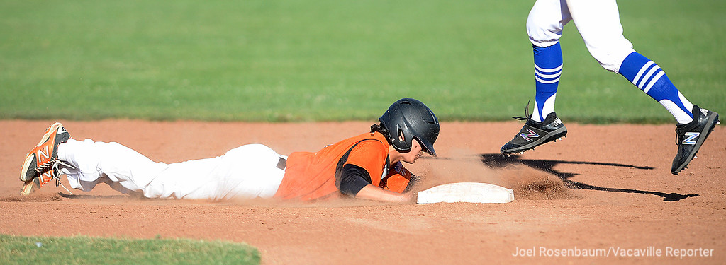 . Vacaville High School pinch runner, Lenny Gianno dives back safely into second base during a fifth inning rally in the   Bulldogs 11-4 victory in game one of their two-game showdown with Davis High School in the 2018 CIF Sac-Joaquin Section Division I Championship at Sacramento City College.