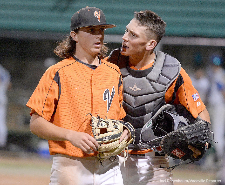 . Vaca High catcher, Cole Elvis congratulates pitcher Devereaux Harrison after he worked out a jam in the sixth inning.
