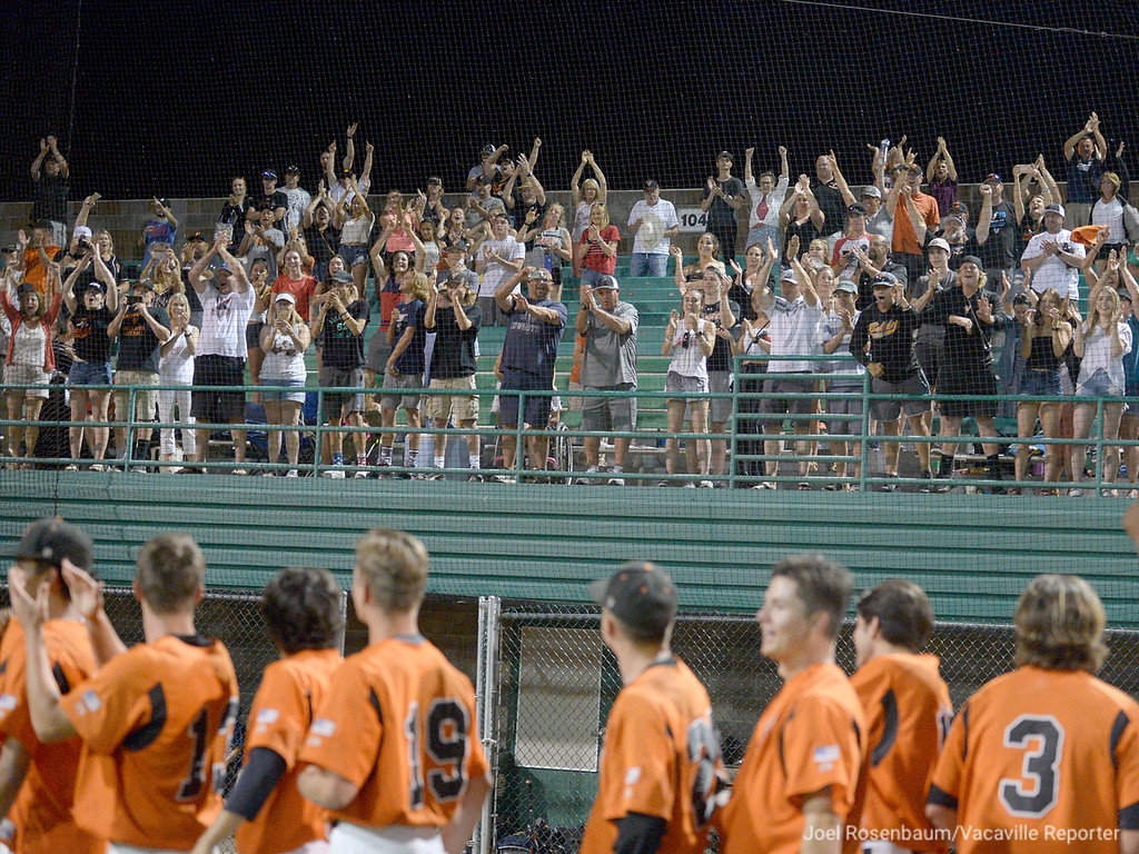 . Vacaville High School fans cheer on the players during the postgame awards ceremony.
