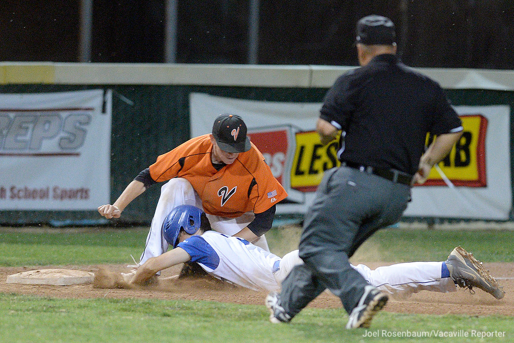 . Vacaville High third baseman, TJ Smith tags out Davis High\'s Jack Painter to record the first out in the top of the seventh inning.