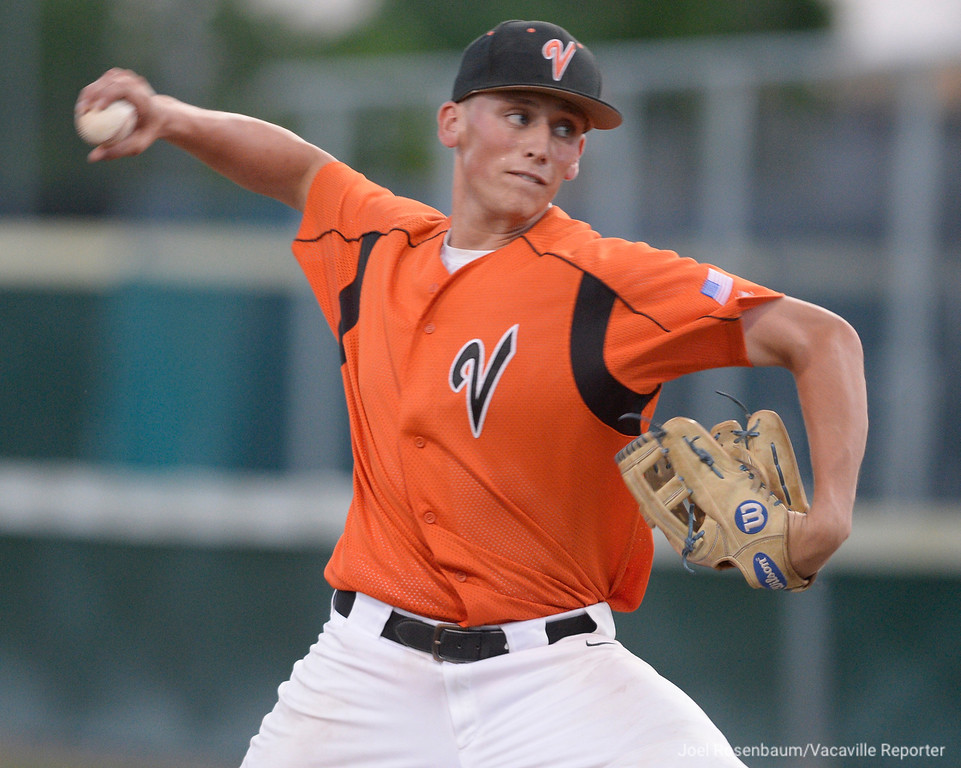 . Vacaville\'s Cole Elvis fire a pitch during the first inning of the second game of the Bulldogs showdown with Davis High School for the 2018 CIF Sac-Joaquin Section Division I Championships Monday at Union Stadium on the campus of Sacramento City College.