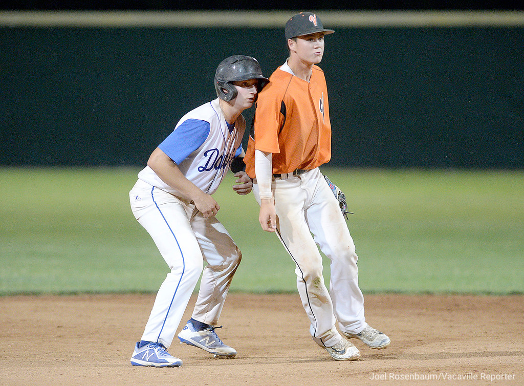 . Vaca shortstop Bryce Begell harasses Davis High\'s Owen Schwab on the base path during the third inning.