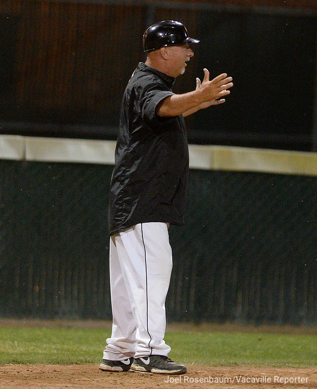 . Vacaville High head coach, Stu Clary reacts as TJ Smith rounds second base after hitting a two-run game-tying home run in the bottom of the seventh inning.