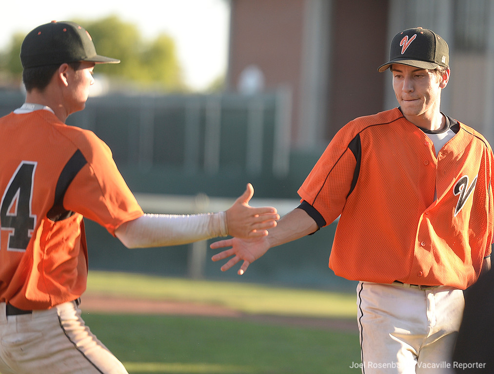 . Vaca High\'s Bryce Begell congratulates pitch Austin Lamb after he worked out a jam to end the sixth inning of the Bulldogs 11-4 victory over Davis High School.