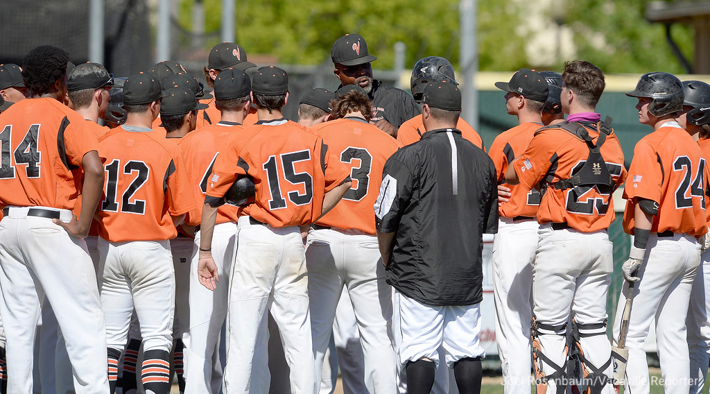 . Vacaville High assistant coach Mike Brown talks with the players before first pitch of game 1 game one of their two-game showdown with Davis High School in the 2018 CIF Sac-Joaquin Section Division I Championship at Sacramento City College.