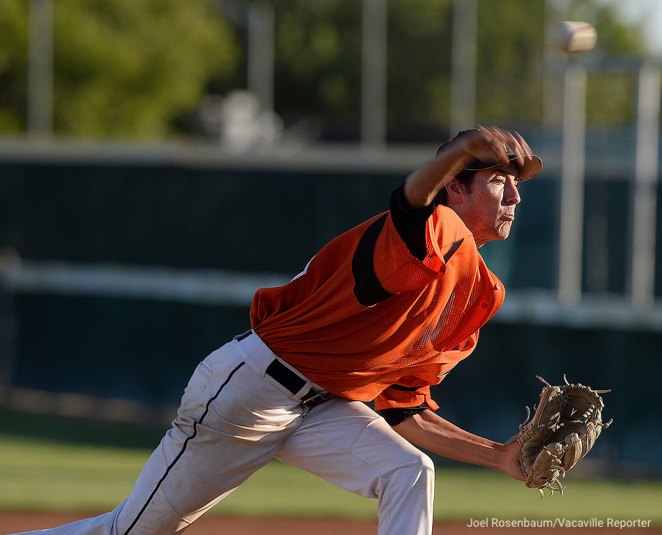 . Vacaville High\'s Austin Lamb fires a pitch during the sixth inning. Lamb entered the game at the end of the fourth inning and finished the game.
