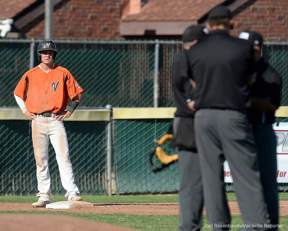 . Vacaville High\'s Bryce Begell waits for a umpire\'s decision on if he scored or not after he ran home on a pick off throw to second base. Begell was eventually called out after batter\'s interference was called on teammate Cole Elvis in the third inning. Elvis was struck out on the play.