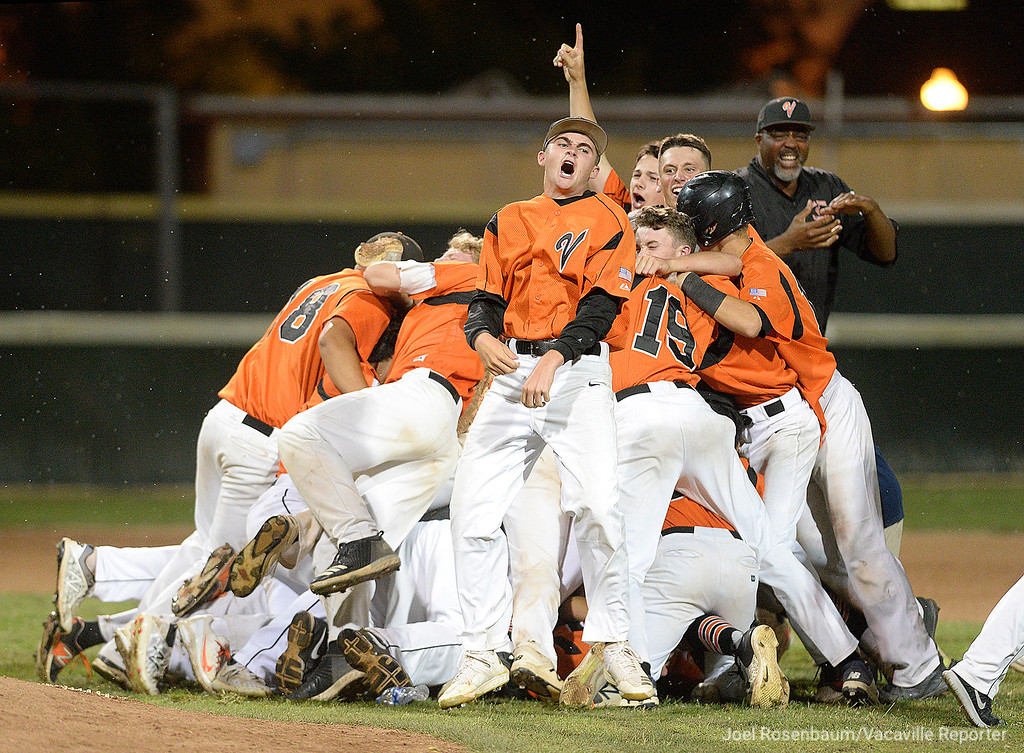 . Vacaville High players celebrate their 7-6 walk-off victory over Davis High School to win the 2018 CIF Sac-Joaquin Section Division I Championships Monday at Union Stadium on the campus of Sacramento City College.