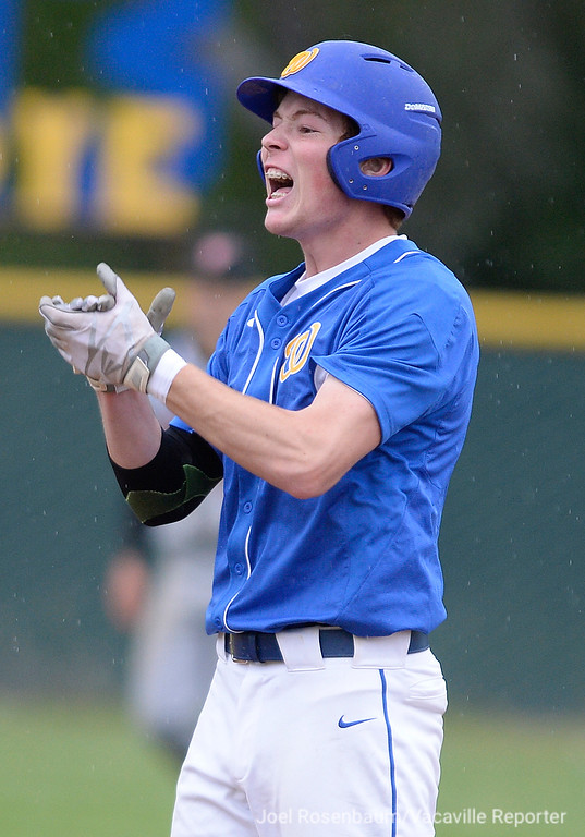 . Will C. Wood\'s Matt Carrier reacts to the cheers of his teammate after his lead off double in the sixth inning.