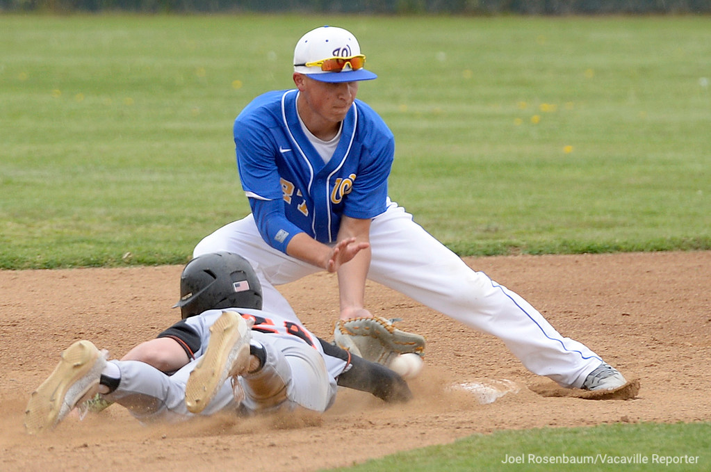 . Vaca High\'s Bryce Begell slides back into second base under the tag of Wood\'s Dylan Fuller on a pick off throw in the second inning.