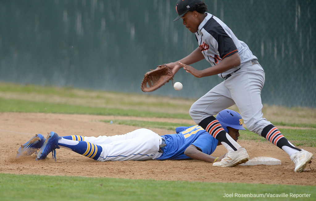 . Vaca High first baseman, Michael Brown can\'t handle a pickoff throw as Will C. Wood\'s, Tyree Reed dives back to the bag during the first inning.