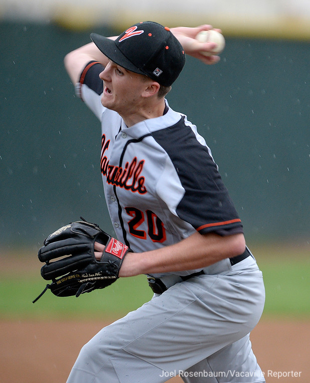 . Vacaville High, Brandon Chalk fires a ptich in the seventh inning of the Bulldogs\' 5-2 comeback victory over their cross town rival, Will C. Wood Thursday at Wood.