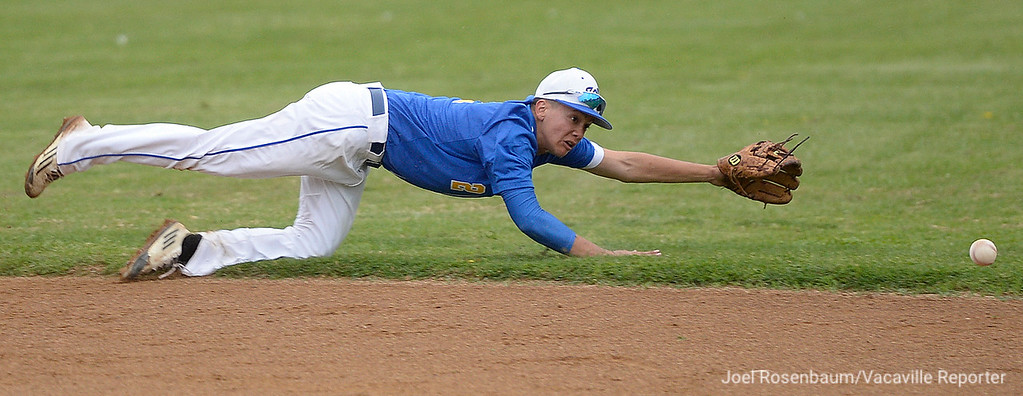 . Wood second baseman, Christian Earwood dives for a ground ball during the Bulldogs\' sixth inning.