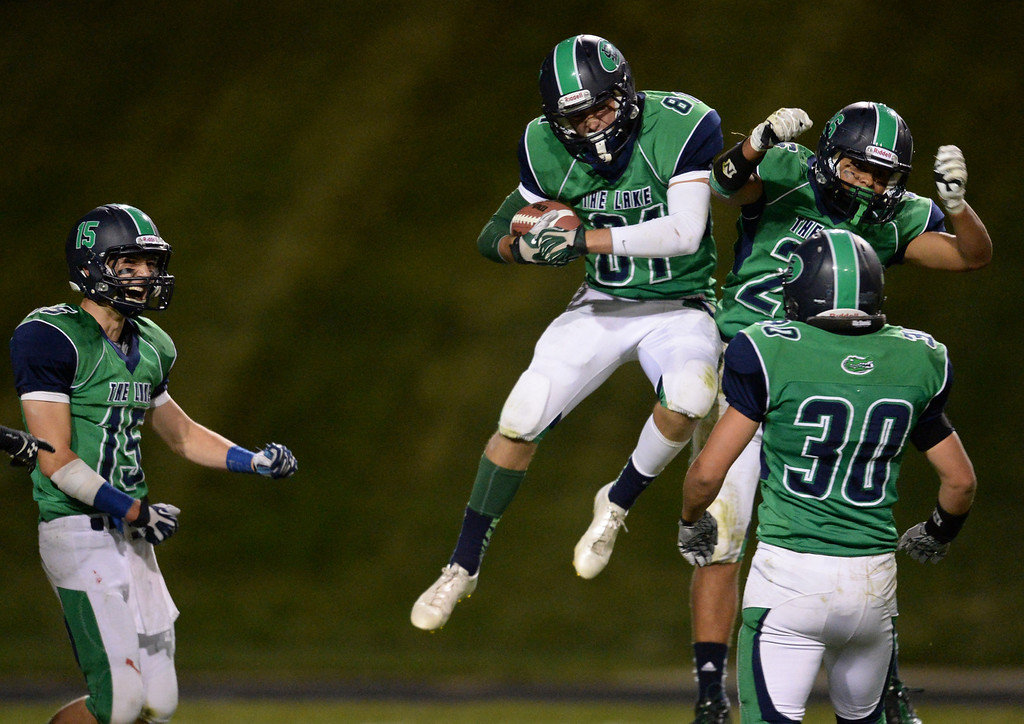 . Arvada, CO - OCTOBER 03 : From left, Matt Fujinami (15), Connor Durant (81), Anthony Moore (26) and Tyler Davis (30) of  Standley Lake High School celebrate turnover against Montbello High School in the 4th quarter of the game at NAAC Stadium. Arvada, Colorado. October 3, 2013. Durant intercepted the ball from A.J. Thompson of Montbello High School. Standley Lake won 31-21. (Photo by Hyoung Chang/The Denver Post)