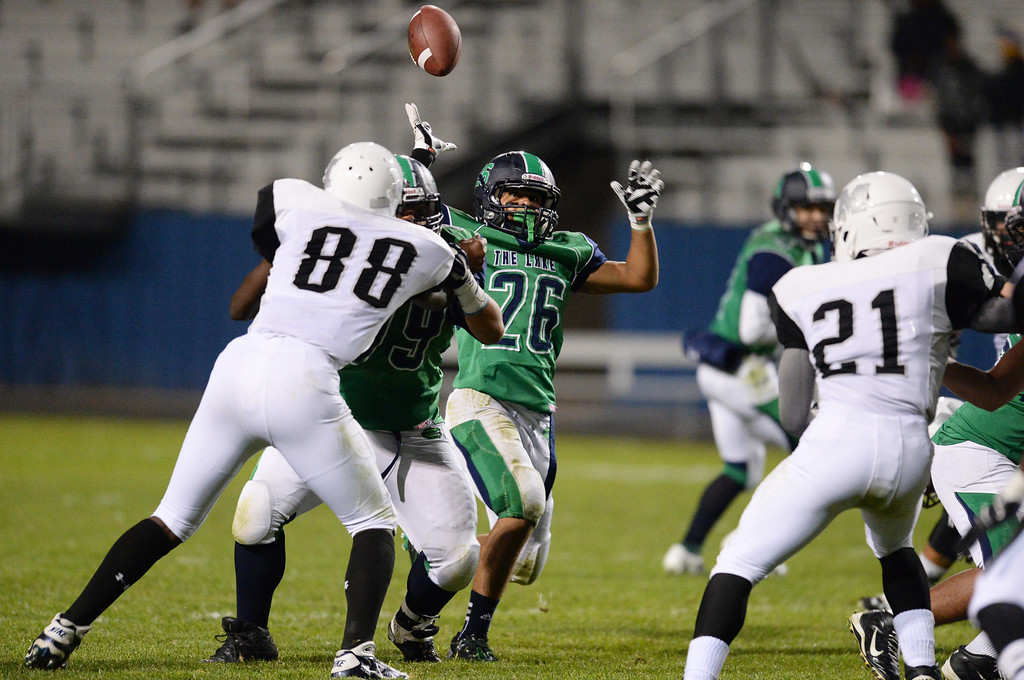. Arvada, CO - OCTOBER 03 : Anthony Moore of Standley Lake High School (26) lost control of the ball in the 2nd quarter of the game against against Montbello High School at NAAC Stadium. Arvada, Colorado. October 3, 2013. (Photo by Hyoung Chang/The Denver Post)
