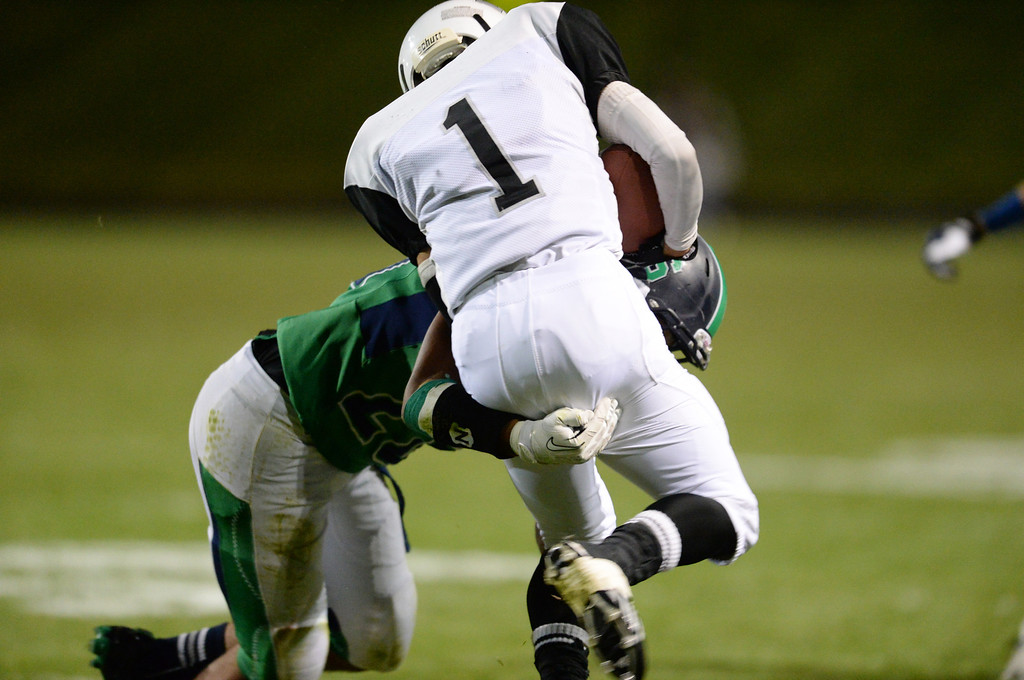 . Arvada, CO - OCTOBER 03 : Anthony Moore of Standley Lake High School (26) tackles Jante Gadson of Montbello High School (1) in the 1st half of the game at NAAC Stadium. Arvada, Colorado. October 3, 2013. (Photo by Hyoung Chang/The Denver Post)