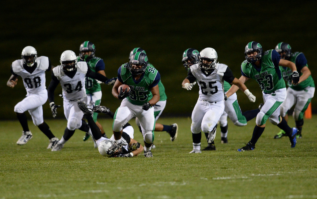 . Arvada, CO - OCTOBER 03 : Jordan Downing of Standley Lake High School (35), front, is rushing for the 1st down in the 1st quarter of the game against Montbello High School at NAAC Stadium. Arvada, Colorado. October 3, 2013. (Photo by Hyoung Chang/The Denver Post)