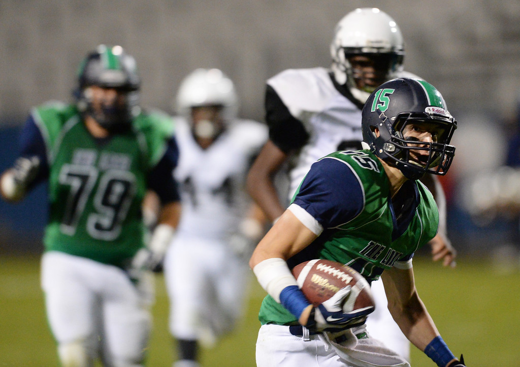 . Arvada, CO - OCTOBER 03 : Matt Fujinami of Standley Lake High School (15) controls the ball against Montbello High School defense in the 4th quarter of the game at NAAC Stadium. Arvada, Colorado. October 3, 2013. Standley Lake won 31-21. (Photo by Hyoung Chang/The Denver Post)