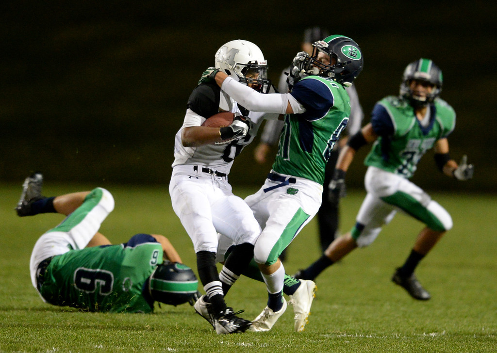 . Arvada, CO - OCTOBER 03 : Connor Durant of Standley Lake High School (81) tackles Marquille Jones of Montbello High School (6) in the 1st half at NAAC Stadium. Arvada, Colorado. October 3, 2013. (Photo by Hyoung Chang/The Denver Post)