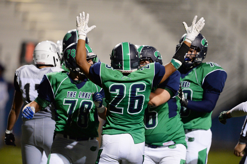 . Arvada, CO - OCTOBER 03 : Anthony Moore of Standley Lake High School (26) celebrates his touchdown with teammates in the first quarter of the game against Montbello High School at NAAC Stadium. Arvada, Colorado. October 3, 2013. (Photo by Hyoung Chang/The Denver Post)