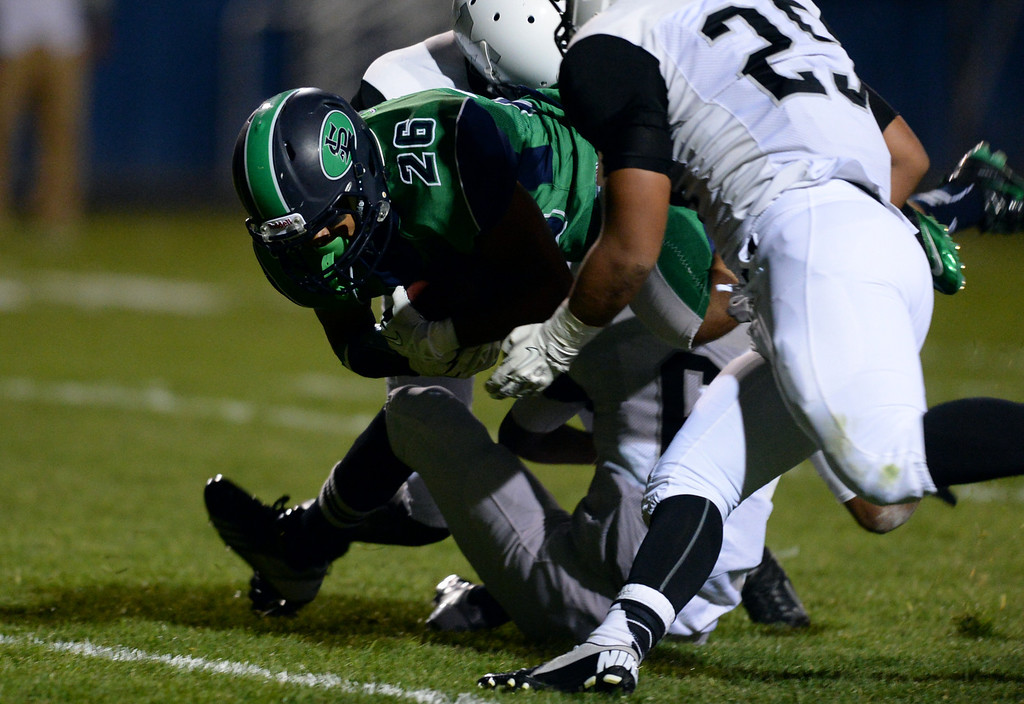 . Arvada, CO - OCTOBER 03 : Anthony Moore of Standley Lake High School (26) dives for the touchdown in the first quarter of the game against Montbello High School at NAAC Stadium. Arvada, Colorado. October 3, 2013. (Photo by Hyoung Chang/The Denver Post)