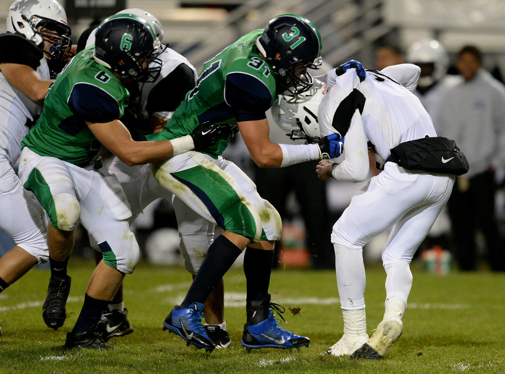 . Arvada, CO - OCTOBER 03 : Trey Jarvis of Standley Lake High School (31) sacks QB A.J. Thompson of Montbello High School (11) in the 4th quarter of the game at NAAC Stadium. Arvada, Colorado. October 3, 2013. Standley Lake won 31-21. (Photo by Hyoung Chang/The Denver Post)