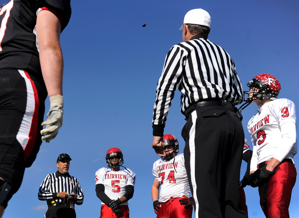. ARVADA, CO. - OCTOBER 18: Captains lined up for the game\'s opening coin toss by the officials. The Fairview High School football team remained undefeated with a 33-30 win over Pomona Friday night, October 18, 2013. The Knights kicked a field goal as time expired in the fourth quarter. Photo By Karl Gehring/The Denver Post