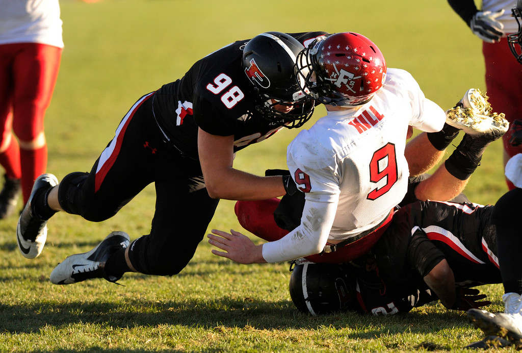. ARVADA, CO. - OCTOBER 18: Pomona lineman Tyler Weir (98) punished Fairview quarterback Anders Hill (9) on his way down to the ground on a sack in the first half. The Pomona High School football team hosted Fairview Friday night, October 18, 2013. Photo By Karl Gehring/The Denver Post