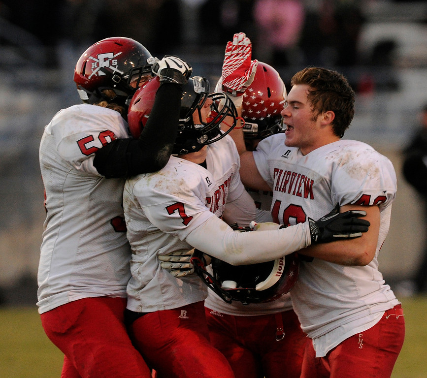 . ARVADA, CO. - OCTOBER 18: The Knights surrounded kicker Jonathan Swartzwelter (7) after he kicked a game-winning field goal as time expired. The Fairview High School football team remained undefeated with a 33-30 win over Pomona Friday night, October 18, 2013. Photo By Karl Gehring/The Denver Post