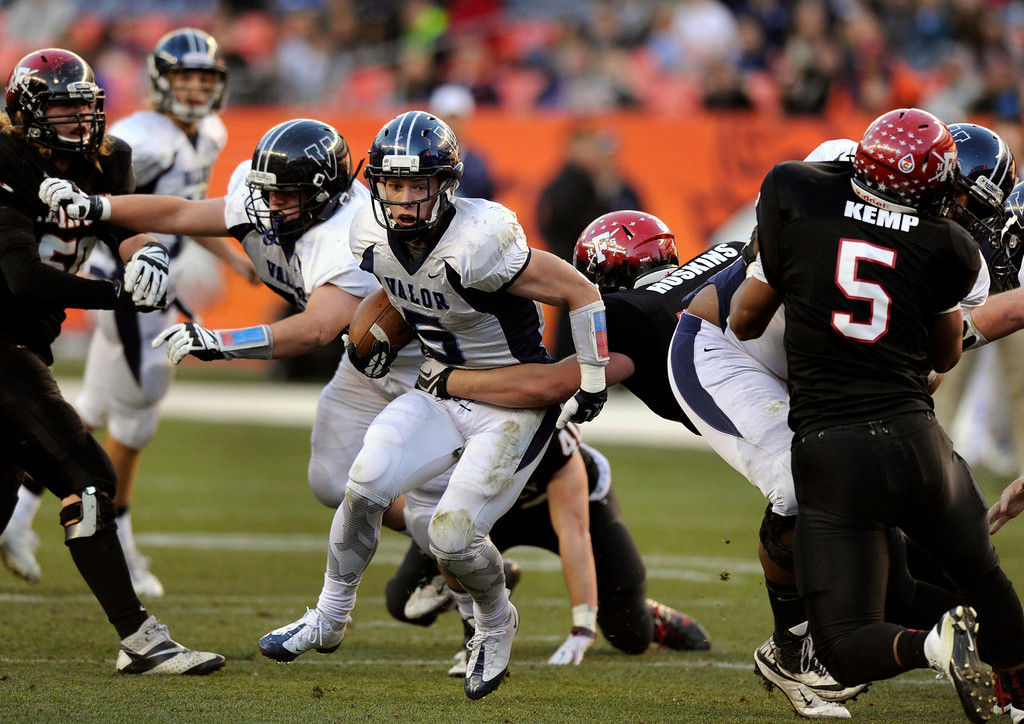 . Eagles\' running back Christian McCaffrey (5) broke out of the grasp of Fairview linebacker Daniel Hoskins (54) in the first half. The Valor Christian football team took on Fairview in the 5A championship game Saturday, November 30, 2013. Photo By Karl Gehring/The Denver Post
