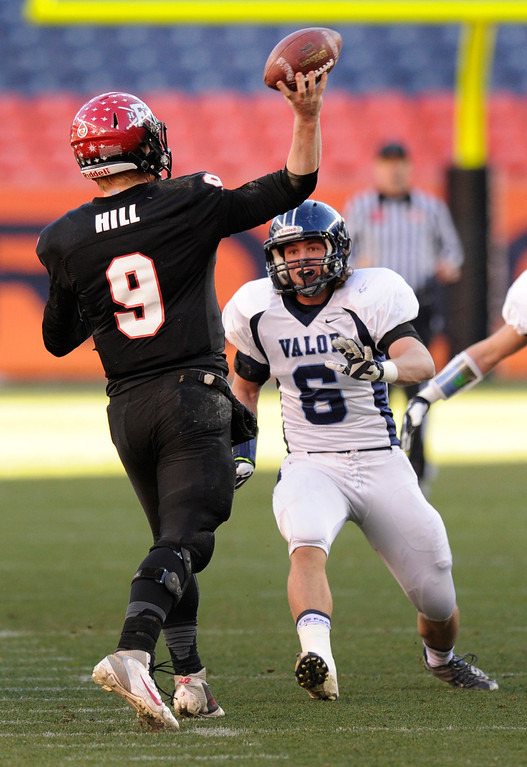 . Fairview quarterback Anders Hill (9) released the ball under pressure from Eagles\' linebacker Lucas Challenger (6)  in the first quarter. The Valor Christian football team rolled past Fairview 56-16 in the 5A championship game Saturday, November 30, 2013. Photo By Karl Gehring/The Denver Post
