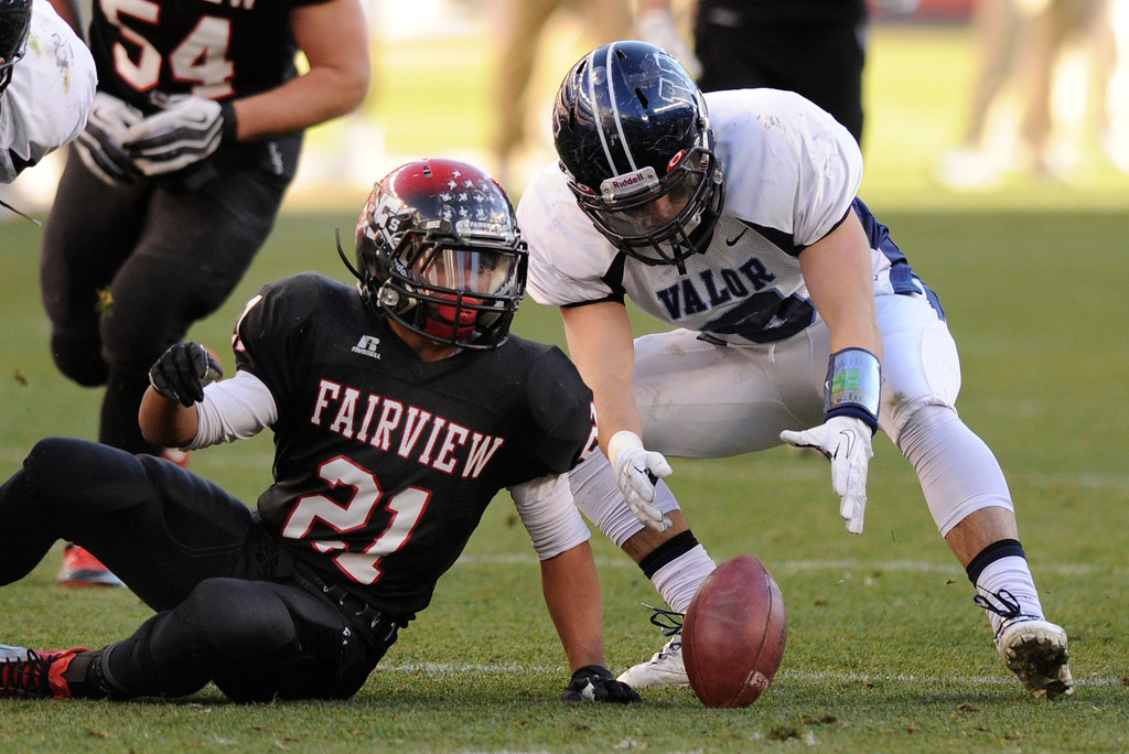 . Fairview ball carrier Connor Twist (21) coughed up the ball in the first quarter. The Eagles\' linebacker David Corral (8)  recovered the fumble.  The Valor Christian football team took on Fairview in the 5A championship game Saturday, November 30, 2013. Photo By Karl Gehring/The Denver Post