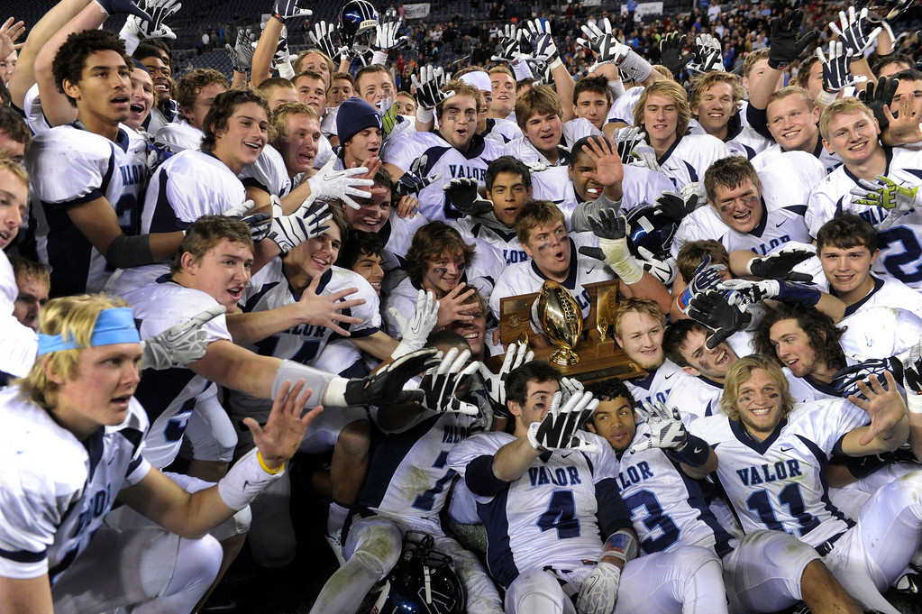 . The Eagles\' celebrated the team\'s fifth straight state title Saturday. The Valor Christian football team rolled past Fairview 56-16 in the 5A championship game Saturday, November 30, 2013. Photo By Karl Gehring/The Denver Post