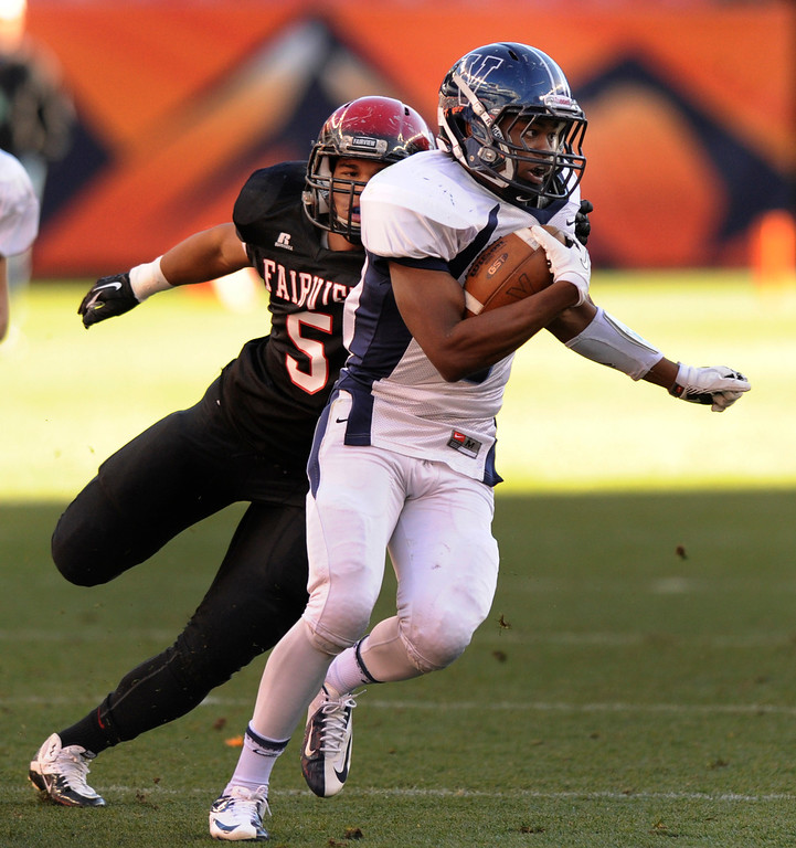 . Valor wide receiver Eric Lee Jr. (7) scored on a reverse after he got by Fairview defensive end Carlo Kemp (5) in the first quarter. The Valor Christian football team took on Fairview in the 5A championship game Saturday, November 30, 2013. Photo By Karl Gehring/The Denver Post