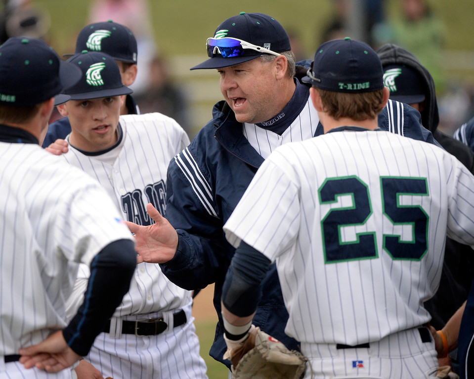 . ThunderRidge coach Joe White talked to the team between innings. The Mountain Vista High School baseball team blanked ThunderRidge 3-0 Wednesday afternoon, April 16, 2014. (Photo by Karl Gehring/The Denver Post)