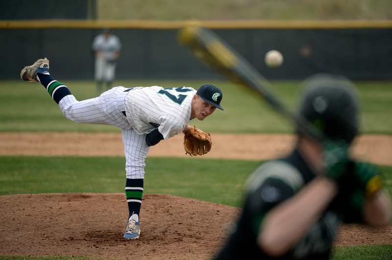 . ThunderRidge pitcher AJ Jones delivered a pitch to Mountain Vista batter Michael Dunnebecke in the fifth inning. The Mountain Vista High School baseball team blanked ThunderRidge 3-0 Wednesday afternoon, April 16, 2014. (Photo by Karl Gehring/The Denver Post)